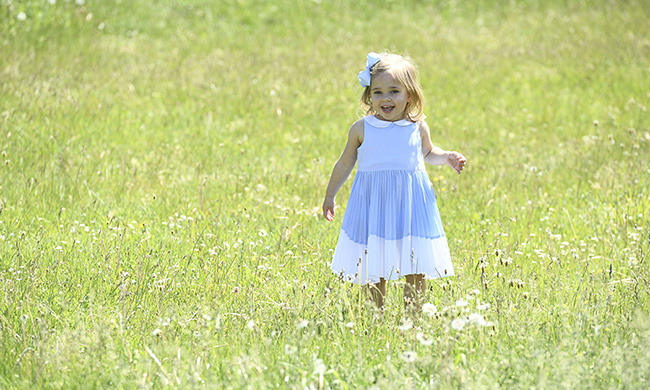 The little girl carried out her first ever royal engagement in June, visiting a horse farm in her duchy Gotland province. The two-year-old, who looked adorable in a white and blue frock with a matching blue bow in her hair, was pictured sweetly running around the farm barefoot.