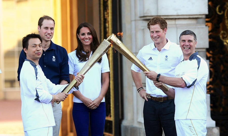 The Duke and Duchess of Cambridge along with Prince Harry watched the Olympic Torch be passed on at Buckingham Palace during the London 2012 Olympic Torch Relay.