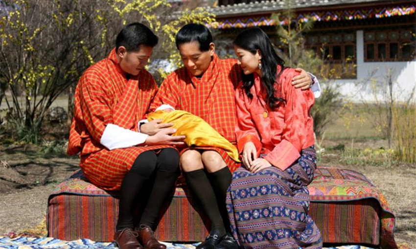 The first photo of their new baby released by the royal couple featured proud grandpa His Majesty the Fourth Druk Gyalpo, who cradled the four-day old baby boy on his lap as he sat between the new parents.