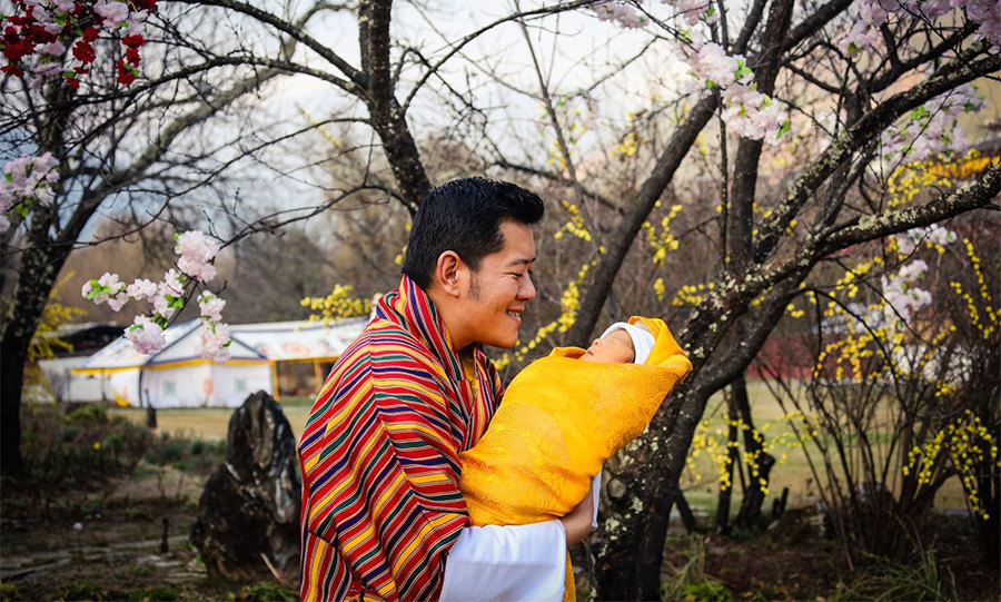 King Jigme is the picture of happiness as he gazes at the little heir in this sweet snapshot. 