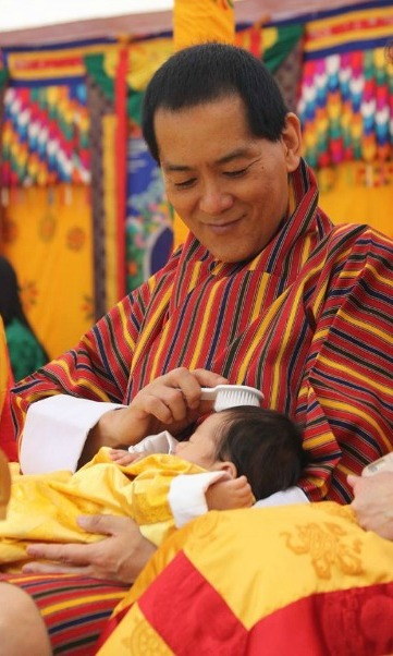 Jigme's grandfather gently brushes the little boy's hair in this sweet snap.