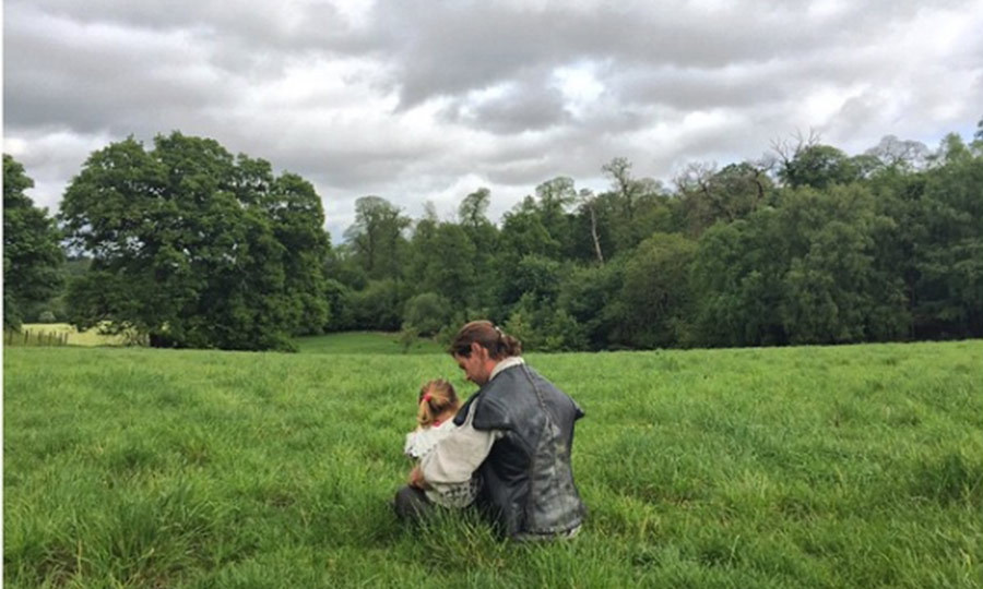 During a trip to London, India Rose got to visit her father on the set of <i>The Hunstman: Winter's War</i>. Documenting their reunion, Elsa uploaded this sweet picture of their daughter sitting on Chris' lap.