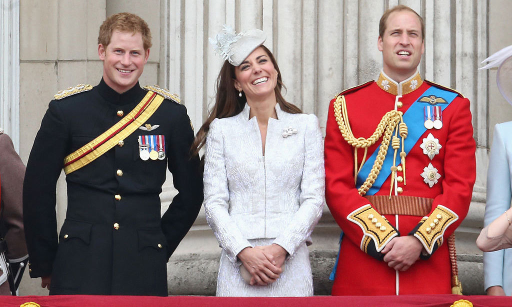 Kate couldn't help but smile as she stood with her brother-in-law and husband on the palace balcony during the 2014 Trooping the Colour.