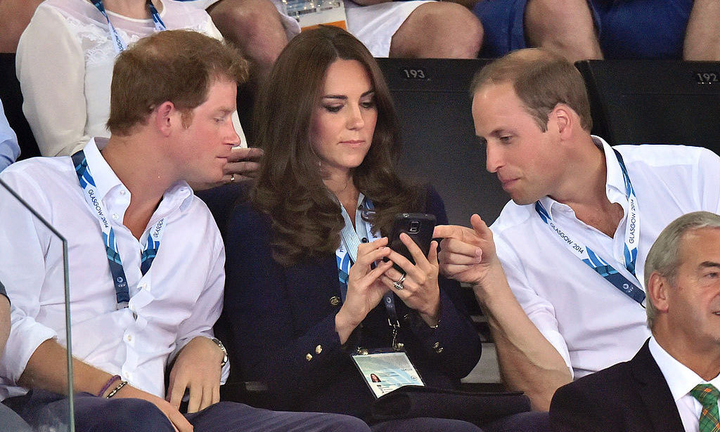Sign us up for their group chats! Harry and William peered over at Kate's phone, during the 2014 Commonwealth Games.