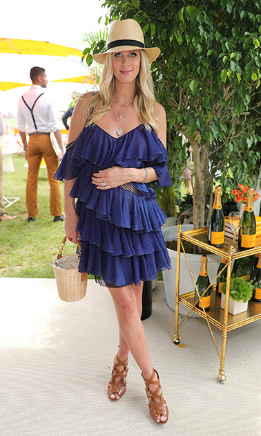 The fashionista showed off her best spring style at the Veuve Clicquot Polo Classic in a blue Philosophy dress. 
