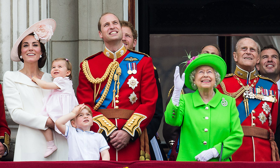 The young Princess was held by her mother, Kate Middleton, as her brother Prince George stood at the front of the balcony next to his father. The young boy gazed up in awe at the RAF flypast that made its way down the Mall and over the palace, leaving trails of red, white and blue smoke.