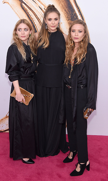 Three's company! Mary-Kate and Ashley worked the red carpet with their little sister Elizabeth during the 2016 CFDA Fashion Awards in NYC. 
