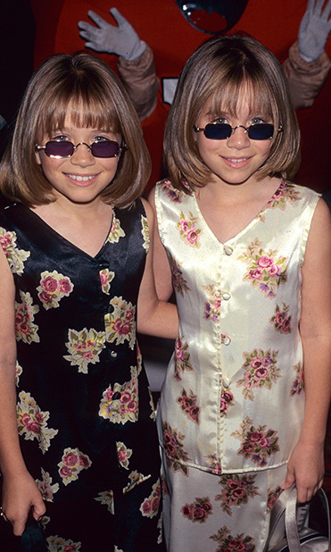 Side by side! Looking super cool – and very Nineties – in their sunglasses and printed outfits during the 1997 Audrey Hepburn Hollywood for Children Family Film Festival.