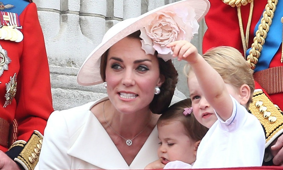 Look mom! Kate Middleton kneeled next to Prince George as he pointed out to something in the horizon from the balcony of Buckingham Palace.