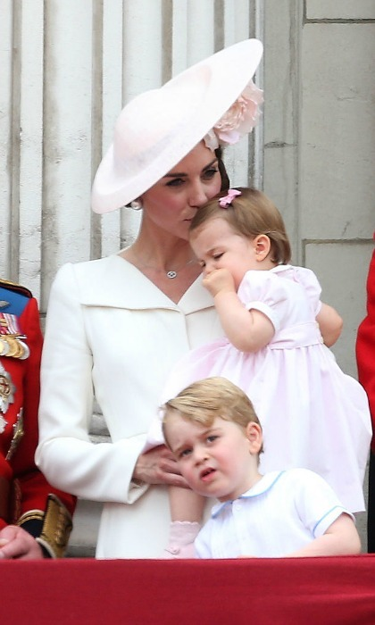Amidst the festivities, Kate sweetly planted a kiss on Princess Charlotte's head as she held her daughter close during the Trooping the Colour.