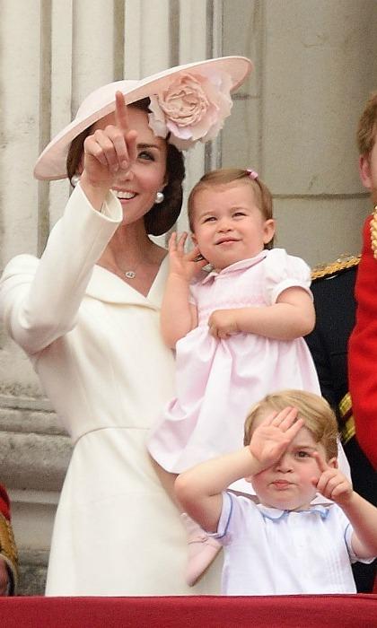 Dressed head to toe in soft pink, the Princess stayed safe in her mother's arms as the royal family watched the RAF flyover.