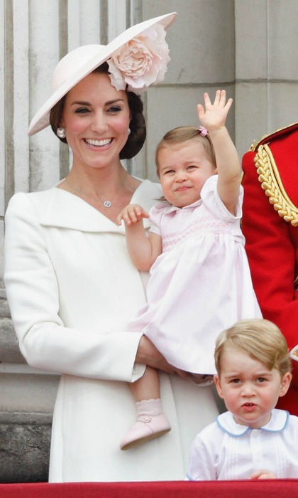 Charlotte gave an adorable royal wave to the spectators who gathered outside the palace gates.