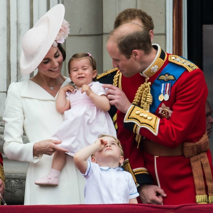Charlotte will always be daddy's princess! William tickled his little girl while on the balcony of Buckingham Palace for the 2016 Trooping the Colour.
