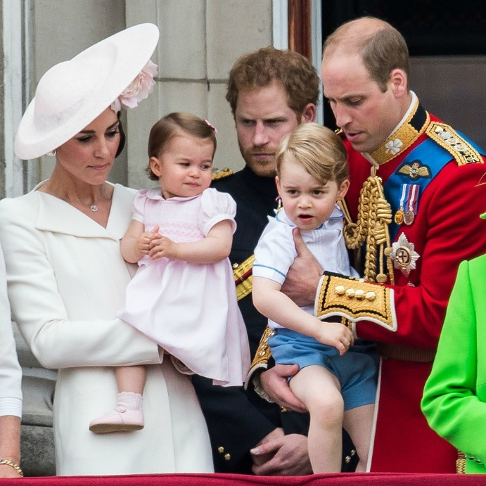 Whoops-a-daisy! Prince William scooped little George into his arms as the family got ready to head back into the Palace 