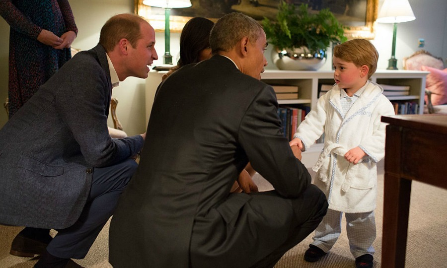 The royal gave his young son an early lesson in foreign policy, introducing the prince (dressed adorably in a bathrobe and pajamas) to the President Barack Obama.