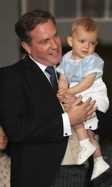 Nicolas was a little restless – but extremely cute! – while cuddled in his father's arms during the christening of his cousin Prince Oscar in September 2016. 