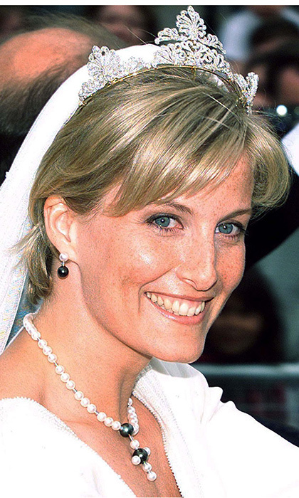 Holding her veil in place, Sophie wore a tiara made up of four open scrollwork motifs. The piece of jewelry came from the Queen's private collection and was designed and remodeled by the Crown Jeweller, David Thomas of Asprey and Garrard.