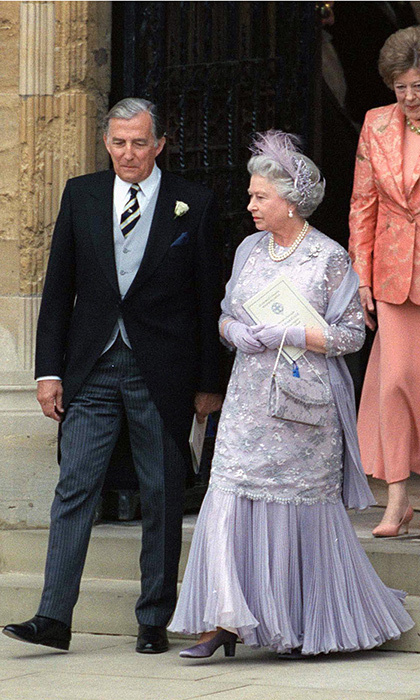 Edward's mother, Queen Elizabeth, looked lovely in a floor-length lilac frock. The monarch finished off her look with a diamond hairslide and a purple feather feature.
