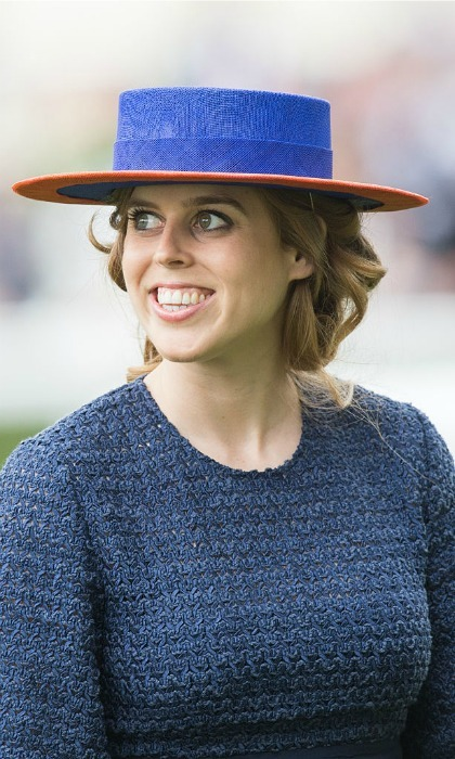 Like grandmother, like granddaughter! Princess Beatrice looked excited on the track following Her Majesty's suit, wearing a blue ensemble with a matching boater hat that featured an orange trim.