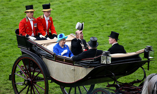 Prince Philip tipped his hat as he entered the Ascot Racecourse with his wife, Queen Elizabeth, in their open horse drawn carriage.