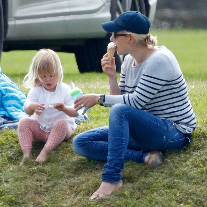 The young girl cooled down with her mom and some ice cream during the Maserati Royal Charity Polo Trophy Match.