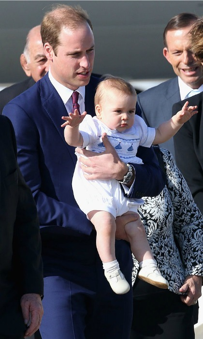 April 2014: Prince George was ready to fly away in the arms of his dad Prince William, while on the Cambridge family's royal tour of Australia and New Zealand.