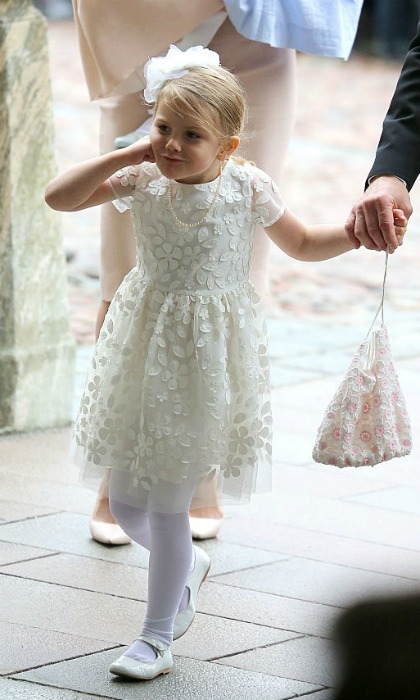 May 2016: Princess Estelle of Sweden made a funny face as she made her way to her brother Prince Oscar's christening. 