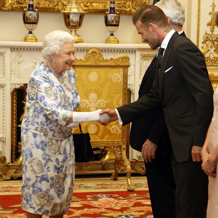 "Shake it like Beckham! Soccer star <a href=""http://us.hellomagazine.com/tags/1/david-beckham/""><strong>David Beckham</strong></a>greeted Her Majesty with a handshake at the Queen's 2016 Young Leaders Awards held at Buckingham Palace. The hunky dad has been involved with the project that discovers, celebrates and supports exceptional young people from across the Commonwealth since 2014.