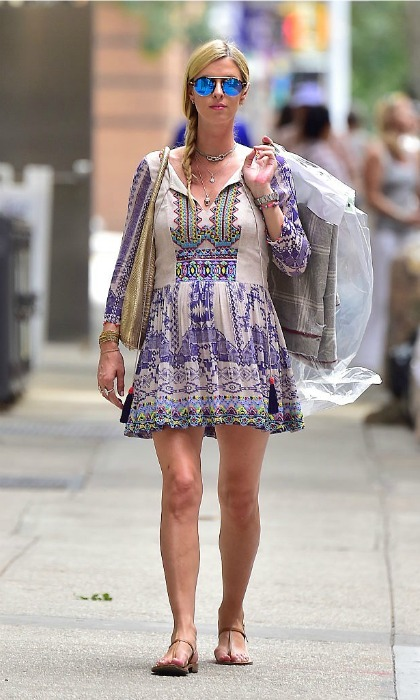 "Nicky was boho chic while doing errands in New York's SoHo neighborhood. The heiress dressed her growing baby bump in a purple printed tunic dress, which she accessorized with sandals and <a href=""http://us.hellomagazine.com/fashion/12016062715475/summer-celebrity-sunglasses-trends/1/""><strong>color saturated sunglasses</strong></a>.