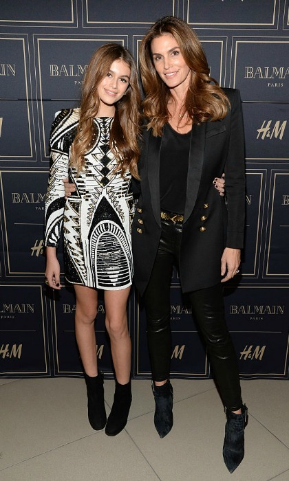 Balmain beauties. The pair donned ensembles from the Balmain x H&M collection at a VIP Pre-Launch in 2015. Cindy and Kaia completed their looks with black booties and styled their brunette tresses down in loose waves.