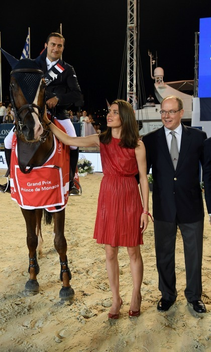 "Prince Albert and  <a href=""http://us.hellomagazine.com/tags/1/charlotte-casiraghi""><strong>Charlotte Casiraghi</strong></a>, in an interesting pair of shoes for the occasion, took a moment to pet one of the horses during the Longines Global Champions Tour of Monaco.