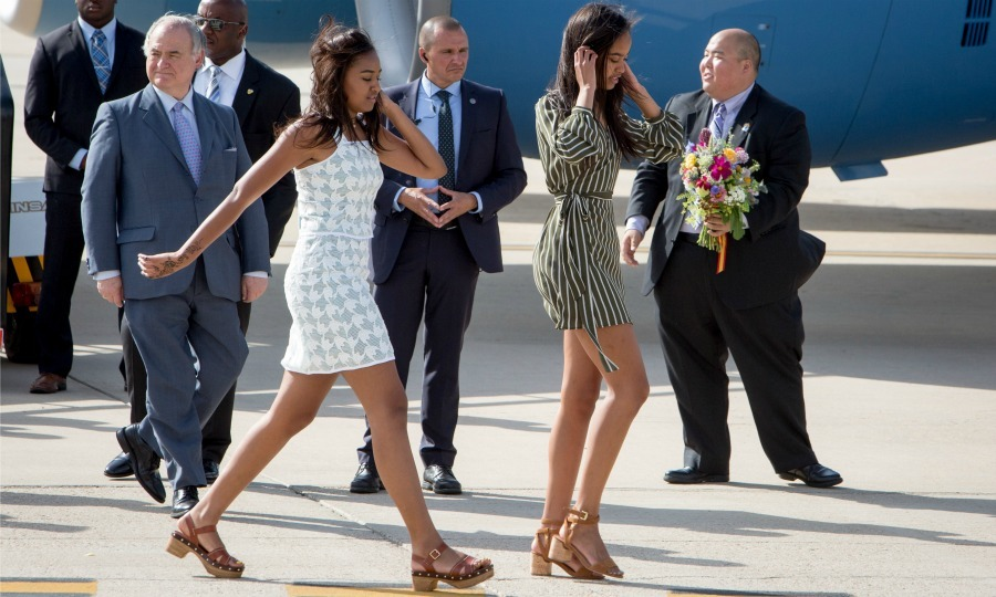 June 2016: Sasha and Malia used the runway at the Torrejon Air Force Base in Madrid as their own personal catwalk. Sasha wore a white sleeveless dress, while Malia rocked a dress with striped detail. The stylish sisters set their looks off with casual brown sandals.