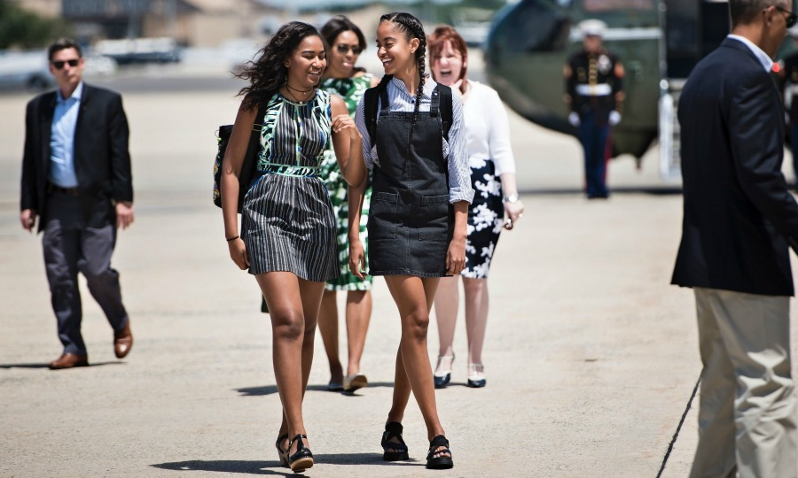 June 2016: On their way to the National Park in New Mexico, Malia went with a more preppy approach, wearing a collar shirt under her dress, while Sasha kept it cool in a simple green and black number. 