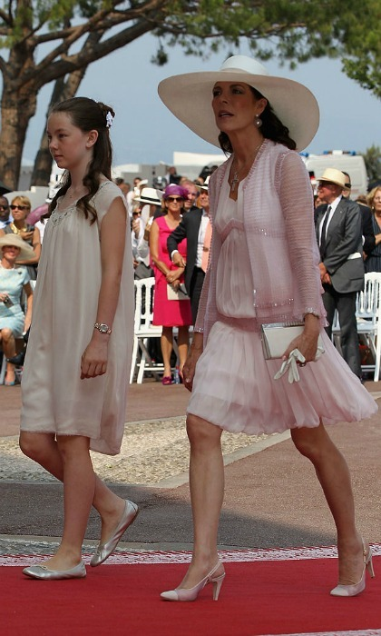 Princess Caroline of Hanover looked pretty in pink with and her daughter Princess Alexandra as they made their way to the couple's courtyard ceremony.