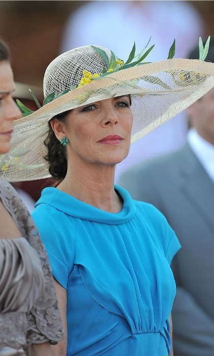 Princess Caroline of Hanover was a vision in blue, topping off her vibrant look with a straw hat adorned with leaves and yellow flowers.