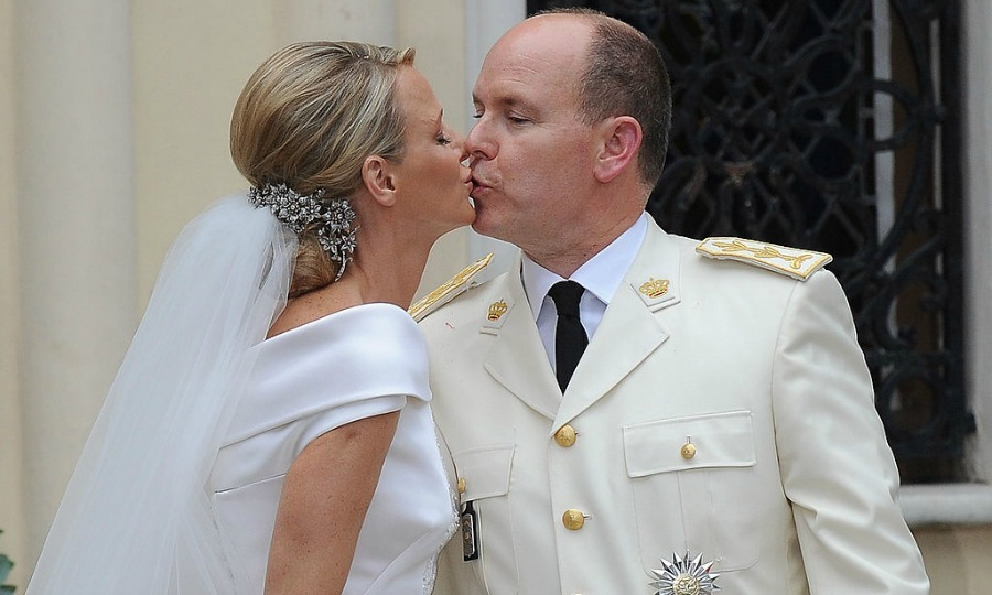A kiss for his bride! Albert tenderly planted a smooch on Charlene as they left Sainte Devote church.