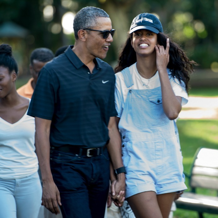 Malia held her father's hand as they strolled around the Honolulu Zoo. 