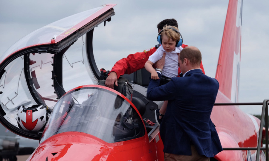 William gives george a helping hand to take a seat in the cockpit.