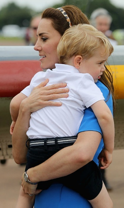 Upon his arrival to the RAF Fairford, George was initially overwhelmed by his surroundings. Thankfully the Duchess was there to scoop her little boy up and give him a reassuring cuddle.
