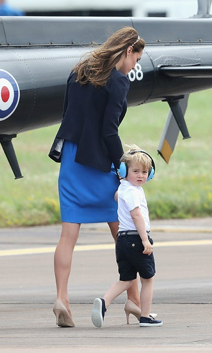 "While out inspecting aircrafts, the adorable Prince asked Kate, ""Mummy, can I fly the Red Arrow now?"" Though William gently told him, ""Not right now.""