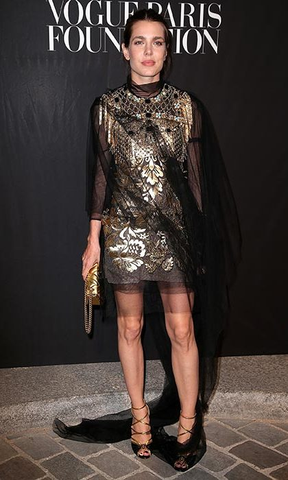 Charlotte Casiraghi wore a dazzling gold and black dress for a Vogue gala in Paris.