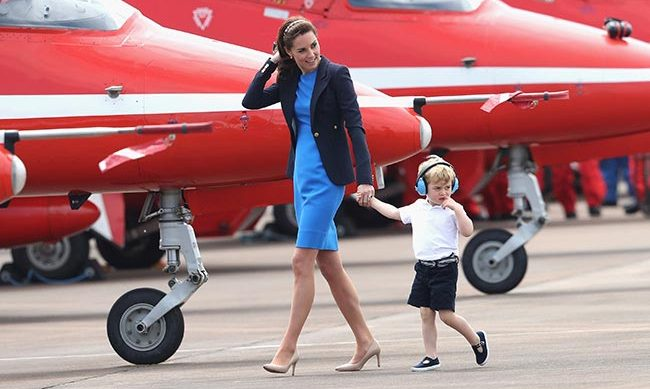 Kate took Prince George on his first UK engagement in a cobalt blue Stella McCartney dress and Smythe blazer.
