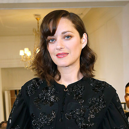 <b>Marion Cotillard</b> could have stepped out of old Hollywood as she arrived for the Dior show, her brunette locks worn down in retro-esque curls with heaps of volume, her fringe styled to the side with a high shine finish for ultimate laidback glamour. 