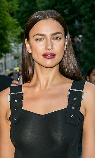 <b>Irina Shayk</b> showed off her gothic side when she teamed a bold dark berry lipstick with a high shine poker straight hairstyle. 