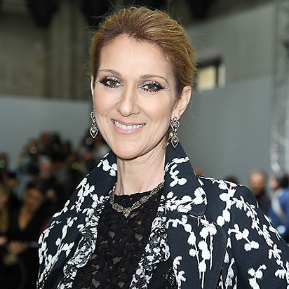 <b>Celine Dion</b> upped the beauty stakes for the Giambattista Valli show with this striking black winged eyeliner and pale blue eyeshadow combination, complemented by her elegant chignon hairstyle. 