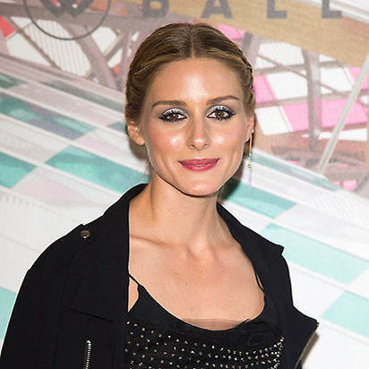 <b>Olivia Palermo</b> ditched her trademark minimal make-up look in favor of this gorgeous pale blue eyeshadow and pink lipstick combination, completing the look with long, voluminous eyelashes. 