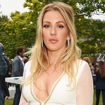 <b>Ellie Goulding</b> channelled boho chic at the Serpentine Summer Party with this elegant half updo, the bottom section left down in loose curls. 