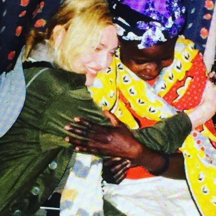 Madonna paid a visit to a lady named Sophie, who is raising her 14 children in Kibera after her husband was killed in war. 