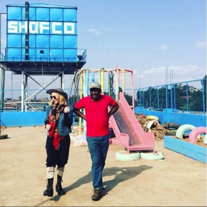 Madonna walked around a playground for students in Kibera with the founder of Shining Hope for Communities, Kennedy. The organization provides goods and services to school girls in the country. 