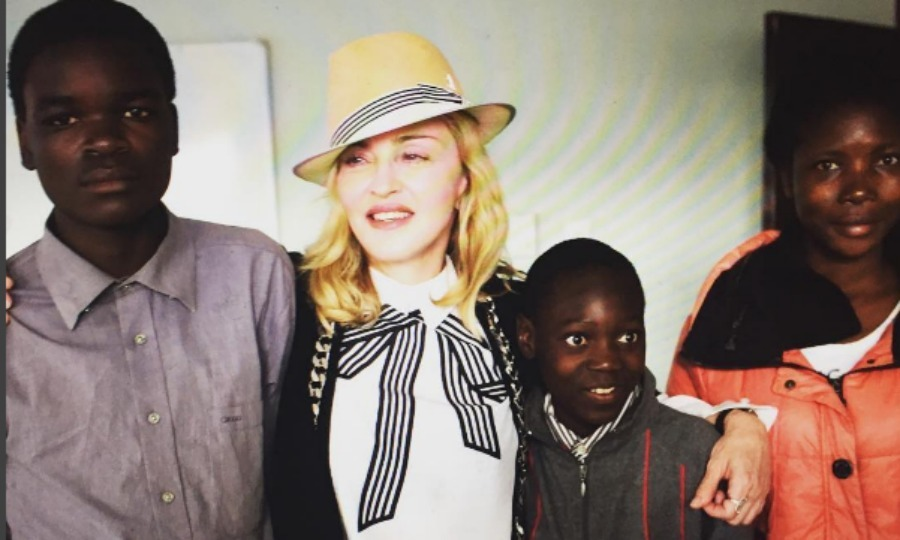 Eight years later, Madonna checked in on students Mavuto, Sinode and Joyce from her film <i>I Am Because We Are</i>. 